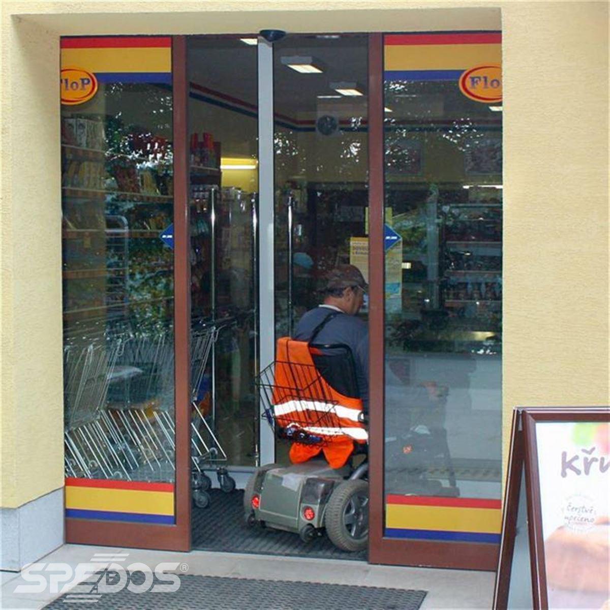 Hnědé automatické posuvné dveře
