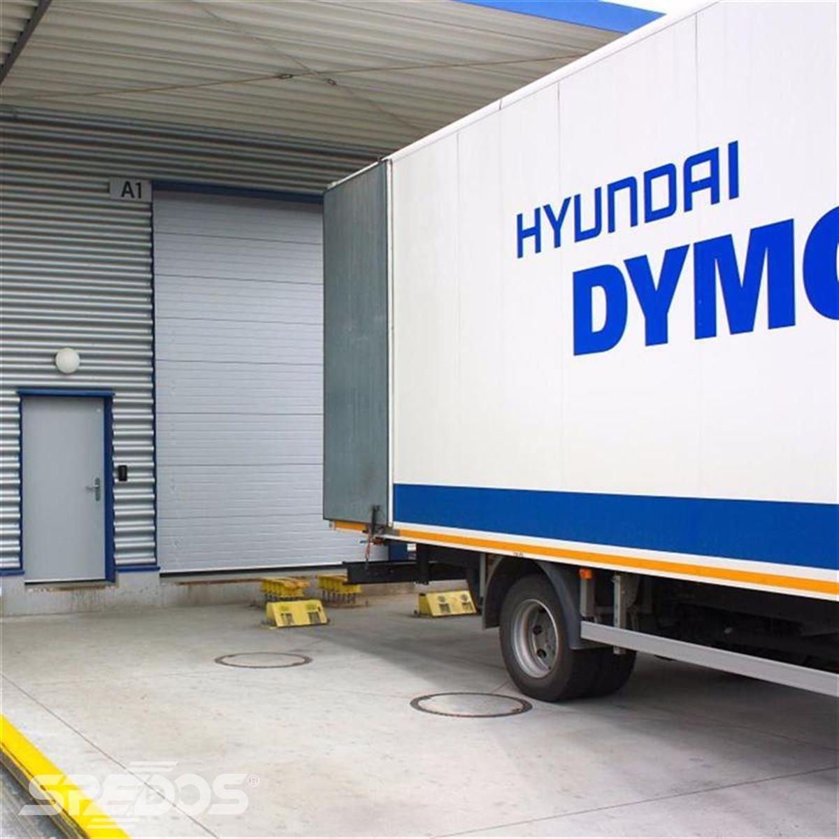 Průmyslová sekční a rychloběžná vrata pro Dymos 2