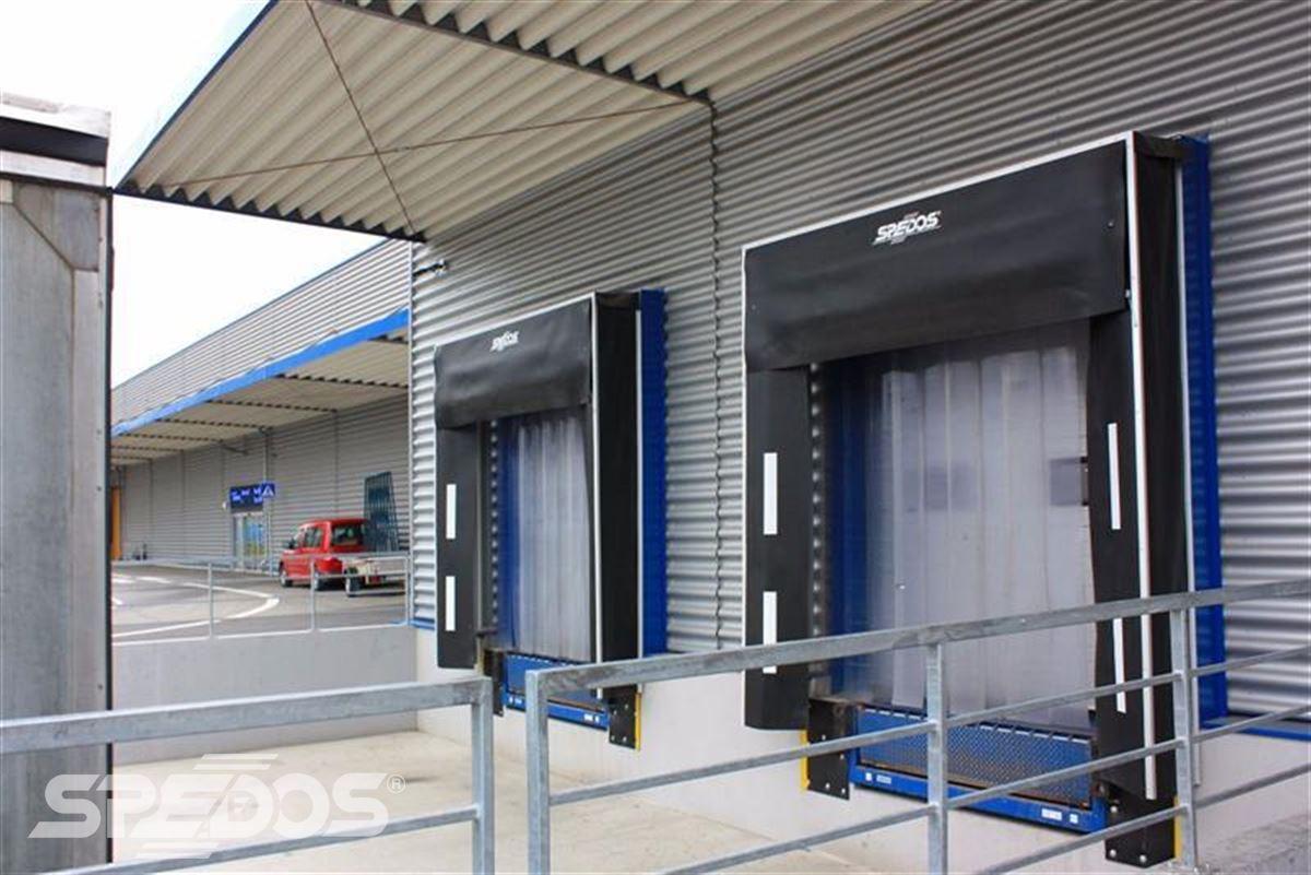 Průmyslová sekční a rychloběžná vrata pro Dymos 6